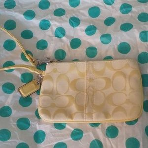 COACH YELLOW SIGNATURE WRISTLET